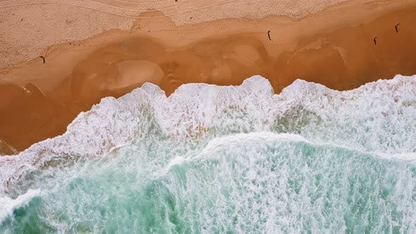 Thumbnail for Aerial Top View of Waves Rolling Towards Sandy Beach. Drone Bird's Eye Footage of emerald ocean