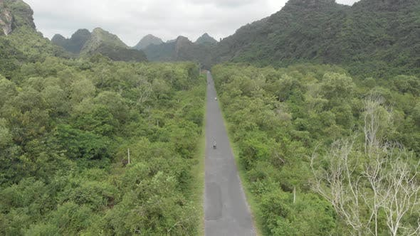Thumbnail for Aerial: people riding scooter inland Cat Ba island, travel destination in Vietnam