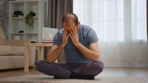 Depressed Man on the Carpet