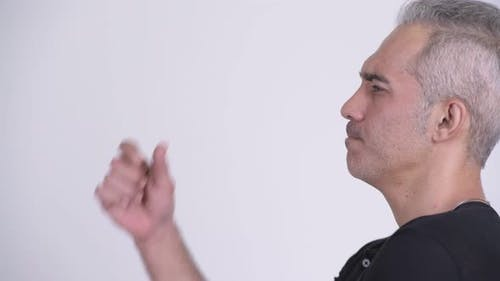 Profile View of Handsome Persian Man Thinking Against White Background