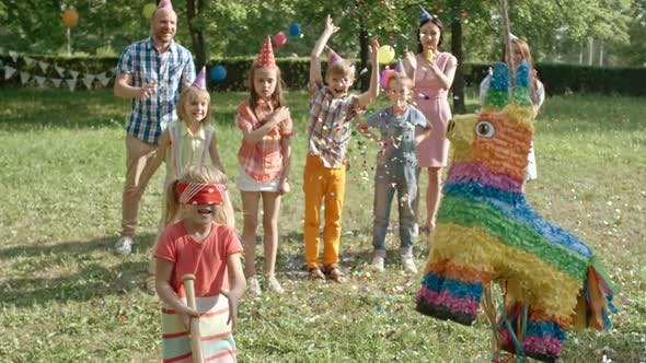 Thumbnail for Birthday Girl Playing with Pinata Outdoors
