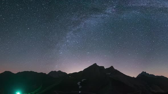 Thumbnail for PAN: Milky Way arc, Comet Neowise and stars in night sky over the Alps