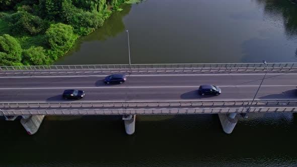 Traffic on the Bridge That Crosses the River