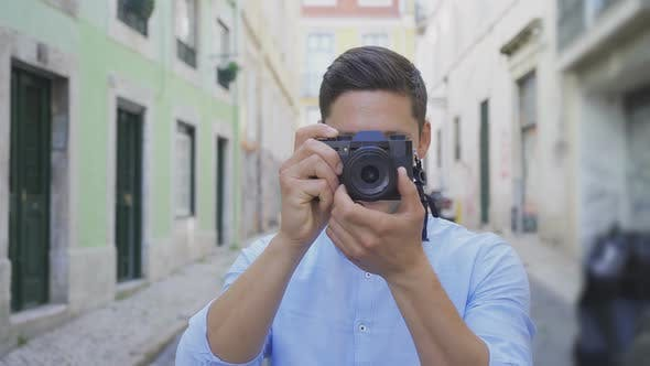 Thumbnail for Front View of Male Photographer with Digital Camera Outdoor
