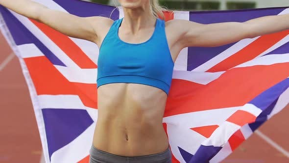 Thumbnail for Smiling Gymnast Celebrating Victory and Holding Flag of Great Britain, Pride