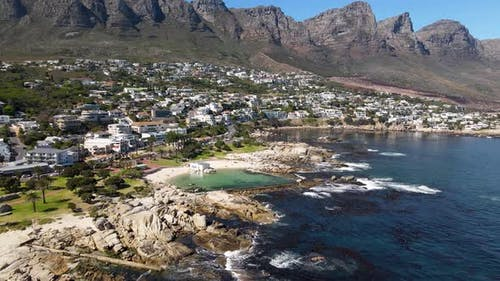 Aerial view of Camps Bay pool Lions Head mountain, Cape Town, South Africa.