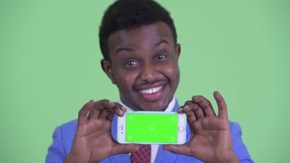 Thumbnail for Face of Happy Young African Businessman Showing Phone