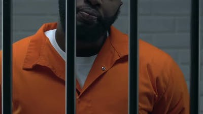 Confident African-American Head of Mafia Standing in Prison Cell, Criminal