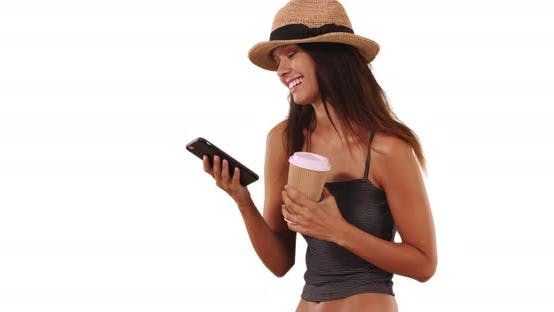 Thumbnail for Cute and stylish young woman with her coffee sending text message on cellphone