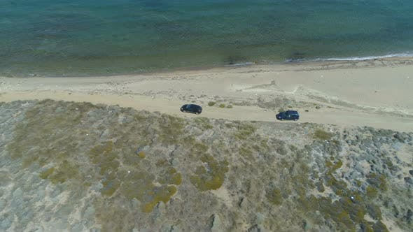 Aerial View of Two Cars Driving at Shore Line in Lemnos, Greece