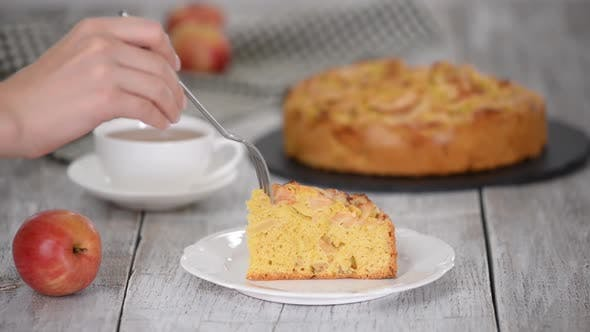 Thumbnail for Piece of delicious apple cake with cup of tea