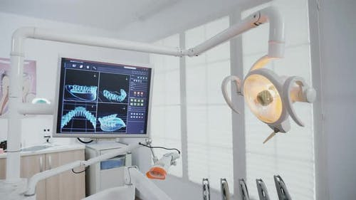 Revealing Shot of Empty Stomatology Orthodontic Office with Teeth Xray Diagnosis Images