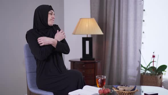 Thumbnail for Portrait of Sad Muslim Woman in Black Clothes Sitting at Home Alone. Upset Beautiful Woman in Hijab
