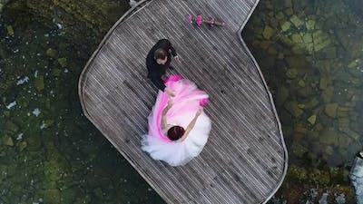 Top Down Aerial View of Wedding Couple Dancing in a Wedding Pier