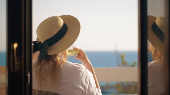 Thumbnail for Woman Drinking Wine and Relaxing at the Balcony Overlooking Sea