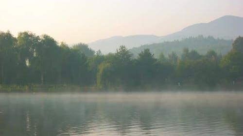 Foggy Morning Over Mountain Lake
