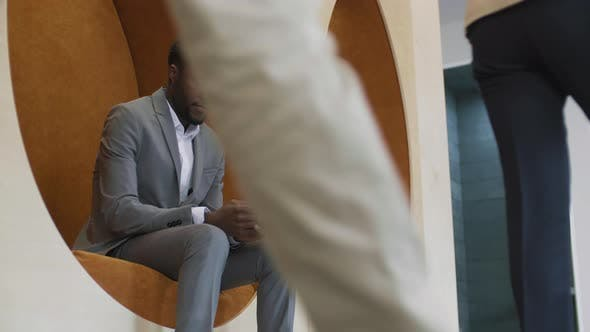 Thumbnail for African-American Businessman Using Mobile Phone