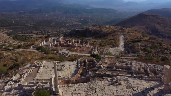 Aerial View of City Ruins with Mountains in the Background