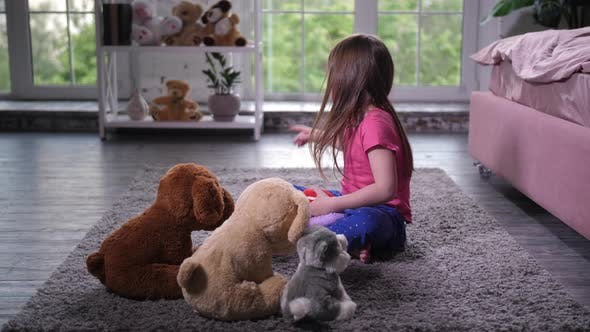 Thumbnail for Cute Child Playing with Teddy Puppies in Nursery