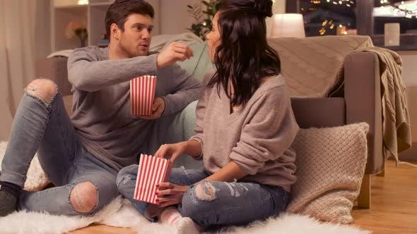 Thumbnail for Happy Couple Eating Pop Corn at Home