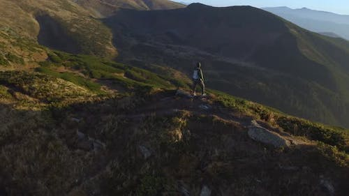 Aerial View of Hiker Man with Backpack on Top of a Mountain