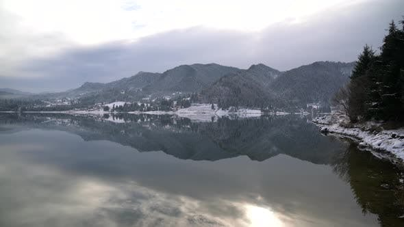 Thumbnail for Sky and hills reflected in water