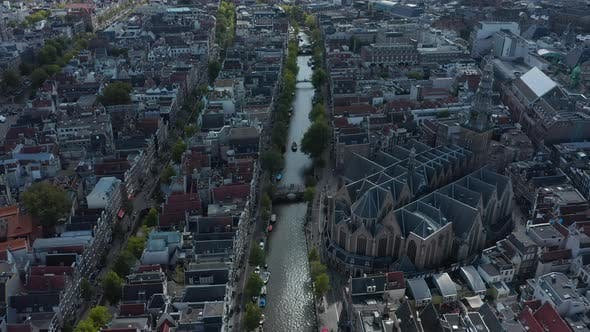 Thumbnail for Birds View of Amsterdam Canal River with Boat Traffic and Old Cathedral