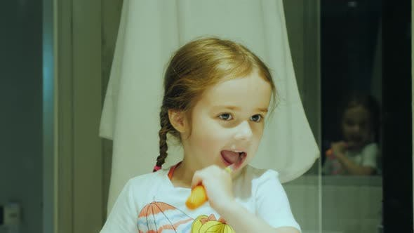 Thumbnail for Healthy Teeth From Early Childhood, a Small Child Cleans His Teeth