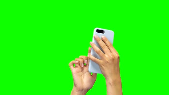 Thumbnail for Hands Using White Smartphone. Green Screen. Close Up. Slow Motion.