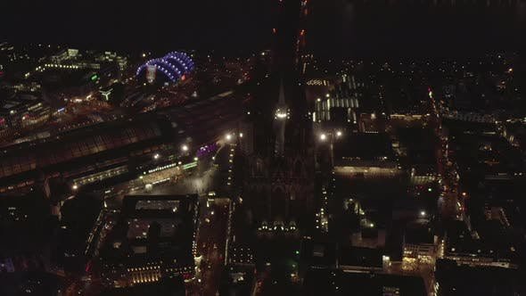 Thumbnail for AERIAL: Beautiful Wide Shot Over Cologne Germany at Night Time with City Lights