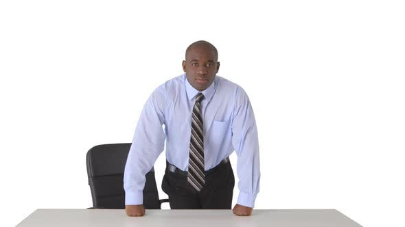 Thumbnail for Confident African American businessman leaning on desk