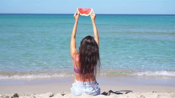 Thumbnail for Happy Girl Having Fun on the Beach and Eating Watermelon