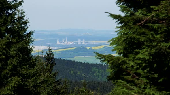 Thumbnail for A Vast Rural Area with a Busy Factory in the Middle, a Coniferous Forest in the Foreground