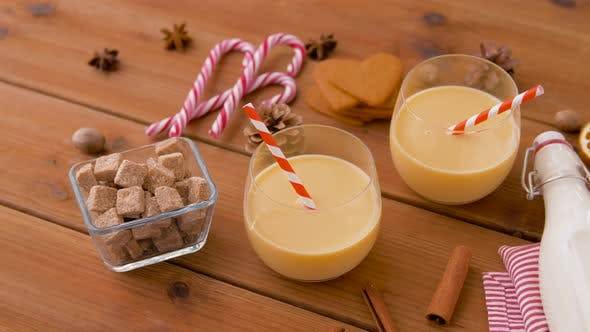 Glasses of Eggnog, Ingredients and Spices on Wood