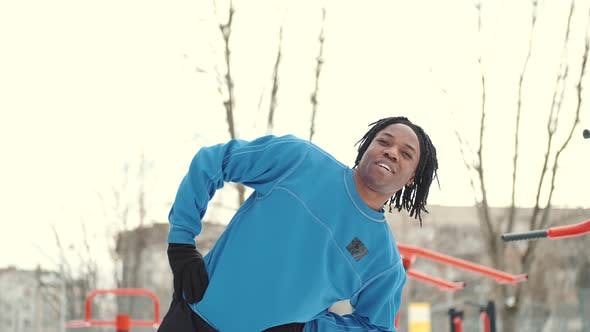 African American Man Footballer Warming Up on Sports Ground