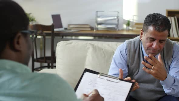 Thumbnail for Stressed Mid-Aged Man Talking to Psychotherapist