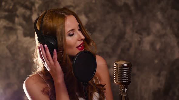 Thumbnail for Woman Recording a Song in Music Studio,slow Motion, Close Up