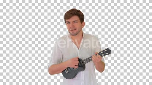 Young man playing ukulele and signing while walking, Alpha Channel