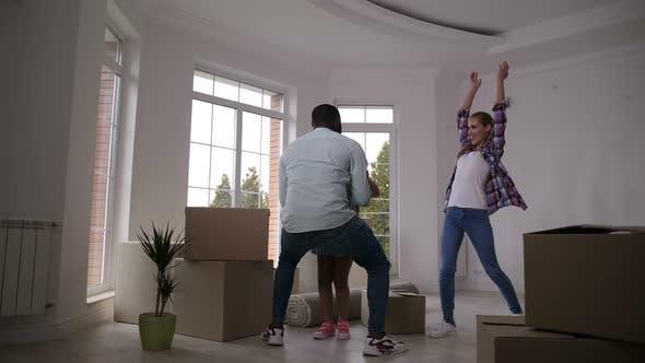 Thumbnail for Happy Family Hugging Taking Break on Moving Day