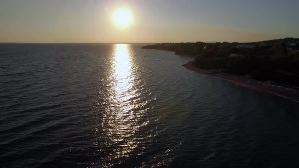 Thumbnail for Aerial View of Shoreline and Sea with Boats at Sunset