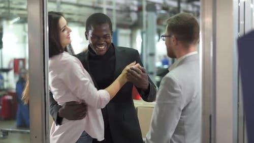 Positive Biracial Family Hugging in Car Dealership