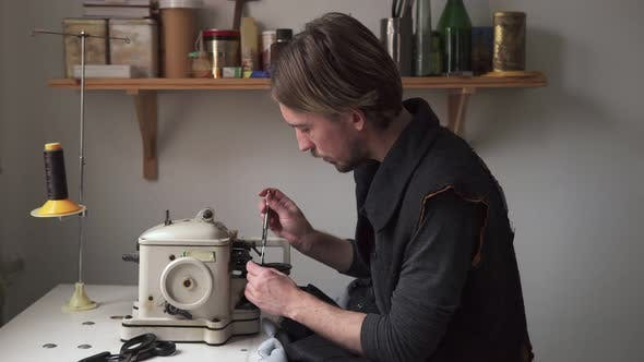 Thumbnail for Man Tailor Sew Fur on Furrier Machine in Workshop