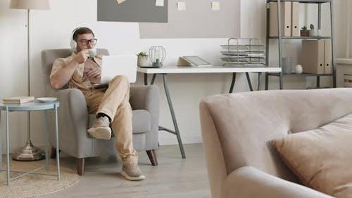 Man Video Calling in Armchair