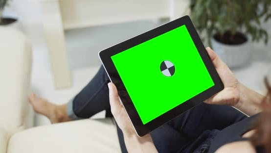 Cover Image for Woman Holding Tablet Chromakey Indoors