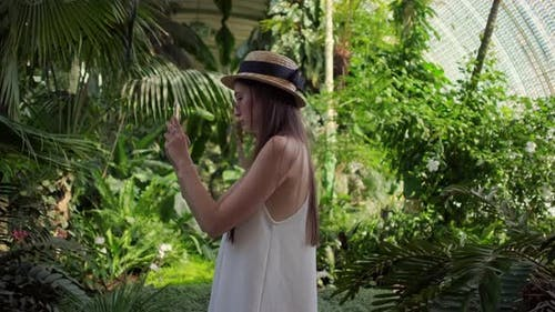 Girl Taking Mobile Pictures in the Greenhouse of Lednice Czechia