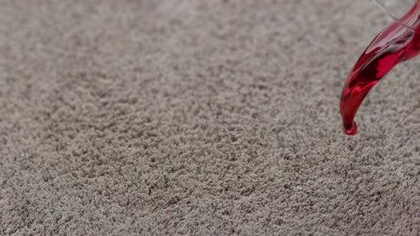 Thumbnail for Glass of cranberry juice spilling on carpet in slow motion; shot on Phantom Flex 4K at 1000 fps