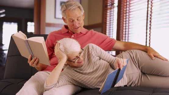 Thumbnail for Happy senior couple reading books on their leisure time