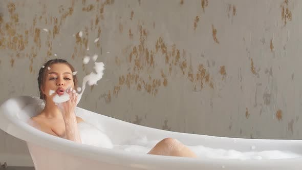 Thumbnail for Attractive Girl with Brown Hair Blowing Foam