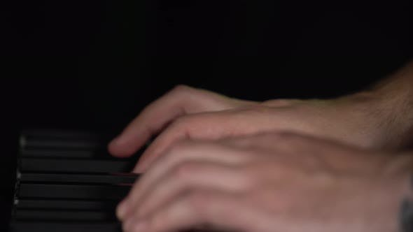 Thumbnail for Male Hands Playing on Synthesizer Piano Keyboard in Dark Studio. Performance Vocal and Musical Band