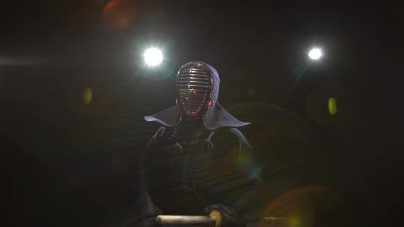 Kendo Guru Sitting on the Floor in an Traditional Armor and Helmet. Dolly Shot